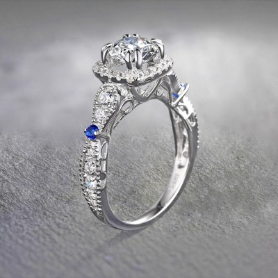 Round Cut White and Blue Sapphire Sterling Silver Halo Engagement Rings